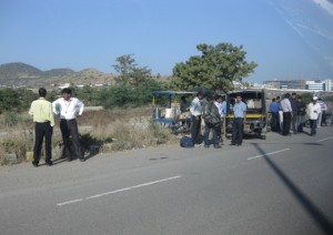 Office Workers and Drivers Mingling at a Roadside Tea Stand